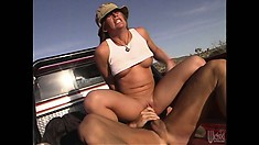 Outdoor sex enthusiast riding her fuckmate in the back of a pickup truck