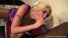 In the toilet, busty blonde Kelly Staxxx fingers her peach and sucks a big black cock