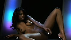 Sultry black slut with big boobies plays with a rubber friend