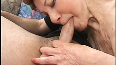 Cock-starved GMILF chokes on a young cock and gets fucked from behind
