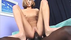 Enticing blonde with tiny boobs welcomes a huge black rod deep in her wet peach