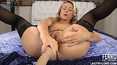 Sensual blonde in black stockings Denis slides a dildo in her butt hole