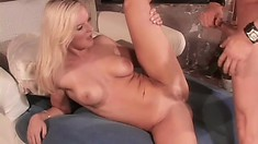 Buxom young blonde slides a cock in her ass and rides it with passion